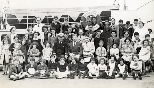 Mr. and Mrs. Kraus and the 50 Jewish children they rescued aboard the ship that brought them to the U.S., 1939